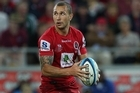 Quade Cooper runs with the ball during the round nine Super Rugby match between the Reds and the Bulls. Photo / Getty Images
