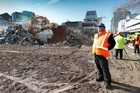 Earthquake Recovery Minister Gerry Brownlee watches demolition work in Christchurch. Photo / Martin Hunter