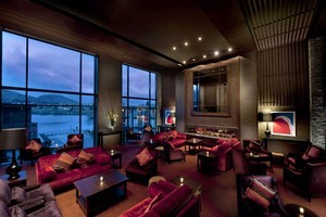 The lobby lounge at Hilton Queenstown affords views across Lake Wakatipu. Photo / Supplied