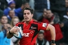 Sean Maitland scores an intercept try for the Crusaders. Photo / Getty Images