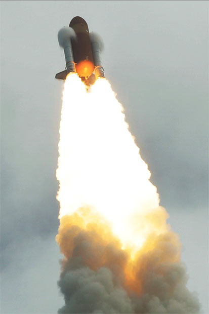 The space shuttle Atlantis lifts off from the Kennedy Space Center. Photo / AP