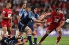 Ali Williams of the Blues passes the ball during the Super Rugby Semi Final match between the Reds and the Blues. Photo / Getty Images