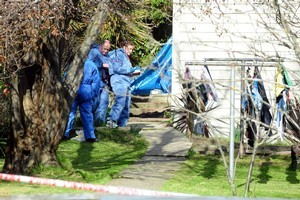Police examine the scene of a serious domestic violence incident in South Dunedin at the weekend. Photo by Craig Baxter.