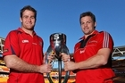 James Horwill and Richie McCaw pose with the Super 15 trophy. Photo / Getty Images