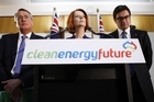 Treasurer Wayne Swan, Australian Prime Minister Julia Gillard and the Minister for Climate Change and Energy Efficiency Greg Combet. Photo / Getty Images