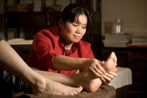 Polly from Bliss Reflexology massages a client - the therapy is based on the premise that the foot 'reflects' other parts of the body. Photo / Michelle Hyslop