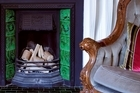 Character features such as fireplaces were intact in the Auckland villa. Photo / Your Home &amp; Garden