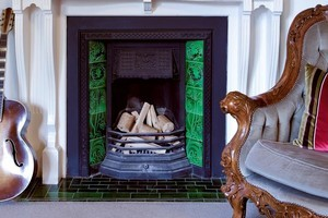 Character features such as fireplaces were intact in the Auckland villa. Photo / Your Home & Garden