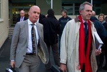 Solid Energy CEO Dr Don Elder (left) leaves the Greymouth District Court with his lawyer Craig Stevens after the first day of the Royal Commission on the Pike River