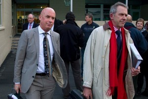 Solid Energy CEO Dr Don Elder (left) leaves the Greymouth District Court with his lawyer Craig Stevens after the first day of the Royal Commission on the Pike River Coal Mine tragedy. Photo / Simon Baker