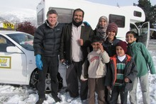 Taxi driver Alan Forrest was a friendly face yesterday for the Alsuhaibani family, who spent Sunday night trapped in their campervan by snowstorms. Photo / Otago Daily Times