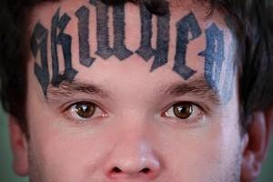 Carl Drewett got 'skinhead' tattooed across his forehead while in prison five years ago. Photo / APN