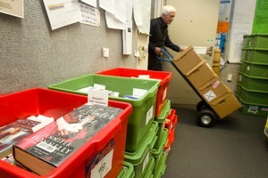 Courier John Forbes delivers books to be sorted and sent to libraries. He may soon receive help from a robot. Photo / Richard Robinson