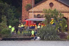 Police diving experts are expected to begin searching Lake Pupuke this morning for the diver who was lost during a training course. Photo / Dean Purcell