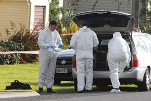 Police forensic officers at the scene of a siege in Opunake. Photo / Rob Tucker