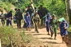 Convict porters (in blue) forced to work for the 