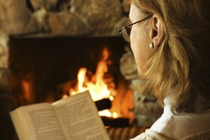 Ignore the balmy weather by snuggling up indoors with a good book at hand. Photo / Thinkstock