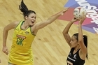 Susan Fuhrmann of Australia (L) attempts to block Maria Tutaia of New Zealand shot at goal. Photo / Getty Images