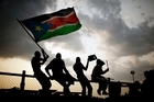 South Sudan raised the flag of its new nation for the first time Saturday, as thousands of South Sudanese citizens and dozens of international dignitaries swarmed the new country capital of Juba to celebrate the country's birth.