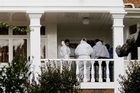 Police and ESR investigators at the Stilwell Road mansion in Mt Albert. Photo / Dean Purcell