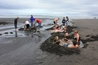 Beach-goers build their own spas at Ocean Beach's Te Puia hot spring. Photo / Supplied