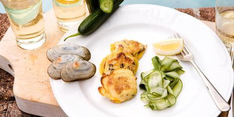 Pipi and mussel fritters with pickled cucumber. Photo / Babiche Martens