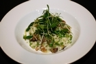 Moon snail and summer pea risotto by chef Richard Ross. Photo / Dean Purcell