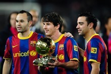 The world's best players - Lionel Messi with the Ballon d'Or, flanked by Barcelona teammates Xavi Hernandez