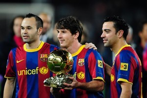 The world's best players - Lionel Messi with the Ballon d'Or, flanked by Barcelona teammates Xavi Hernandez and Andres Iniesta (left) who came second and third respectively. Photo / AP