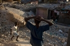 Children play at the rubble of earthquake-damaged houses in downtown Port-au-Prince. Photo / AP
