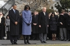 President Barack Obama, first lady Michelle Obama, and government employees observe a moment of silence for those who were killed and injured in the shooting in Tuscon. Photo / AP