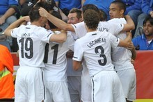 The All Whites celebrate scoring a goal against Italy during the Fifa World Cup. Photo / Brett Phibbs