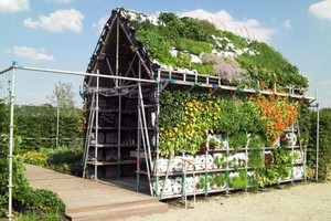 An 'eat house' is made of recyclable materials and easily disassembled, while vegetables grow along its structure.