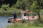 The Coastguard and police divers continue to search  for a missing jet skier on Lake Okareka in Rotorua. Photo / NZPA