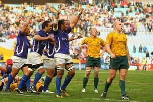 Samoa celebrate their historic win over Australia. Photo / Getty Images