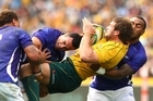 Ben McCalman of the Wallabies is tackled during the match against Samoa. Photo / Getty Images
