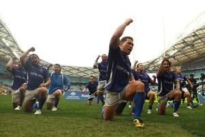Captain Mahonri Schwalger leads Samoa in a war dance as they celebrate victory. Photo / Getty Images