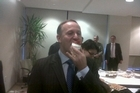 Prime Minister John Key tucks into a mini pavlova on his tour of the United States. Photo / Audrey Young