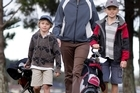 Jo Lintott finds it cheaper to take son William (right, with mate Harrison Clotworthy) golfing. Photo / Natalie Slade