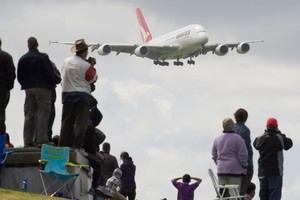 A Qantas Airbus A380 aircraft comes in to land in Auckland. Photo / NZ Herald