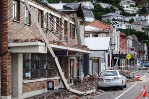 Wrecked buildings line the streets of central Lyttelton after the February quake. Photo / Sarah Ivey