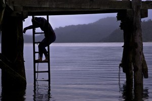A fishing line tangle requires a careful descent from the shaky jetty. Photo / Chris Samsara