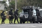 The AOS at the scene of a siege in Opunake. Gunman Tony Ratihi was holed up in The Headlands Hotel with a hostage, before being fatally shot by police. Photo / Rob Tucker