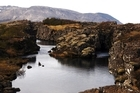 Iceland is a land of volcanoes, earthquakes, geysers, strange geology, glaciers and vast plains. Pictured is a fissure in the earth around the meeting point of the north American and Eurasian tectonic plates. Photo / AAP