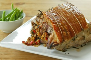 Stuffed roast port with fresh herbs makes a lovely winter dinner. Photo / NZ Herald