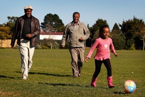 Four-year-old Ruhamah plays ball with her father, Zenebe Tsegi (left) and a family friend at Mt Roskill War Memorial Park. Photo / Sarah Ivey
