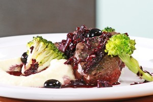 Pan-seared Venison with Thyme, Berry & Red Wine Reduction. Photo / Melodie Brown