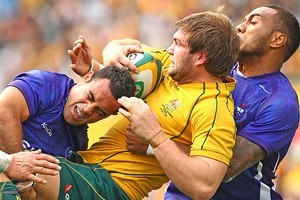 Ben McCalman of the Wallabies is tackled. Photo / Getty Images