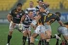 TJ Perenara of Wellington kicks under pressure. Photo / Getty Images