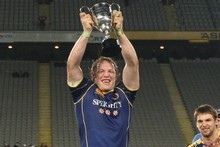 Eben Joubert holds aloft the Lin Colling Trophy after Otago beat Auckland.